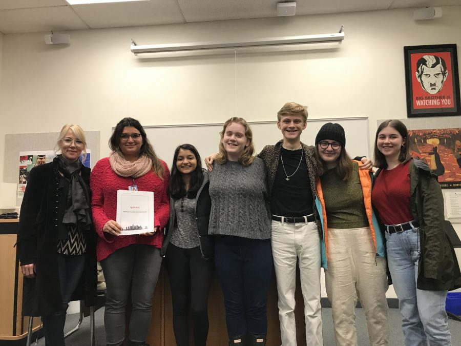 The La Femme Club leaders pose with Jasmine Elbarbary, who educated them about skills necessary for holding Pubic Office positions.  Credit: Annie Beckman