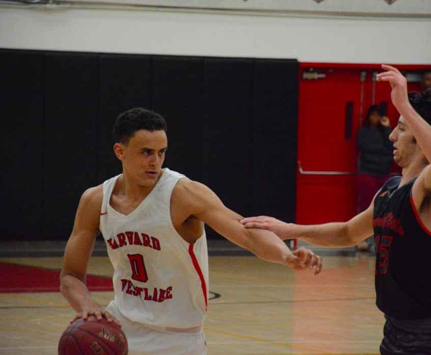 Wing Holden McRae '20 scans the court, while protecting the ball from a defender. Credit: Keila McCabe/Chronicle