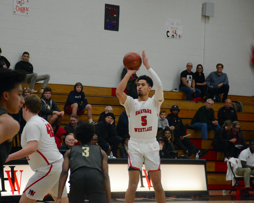 Off of a pick by forward Kyle Hearlihy '19, guard Johnny Juzang '20 shoots his first of three three-point shots in a row to start the first quarter. Credit: Keila McCabe/Chronicle