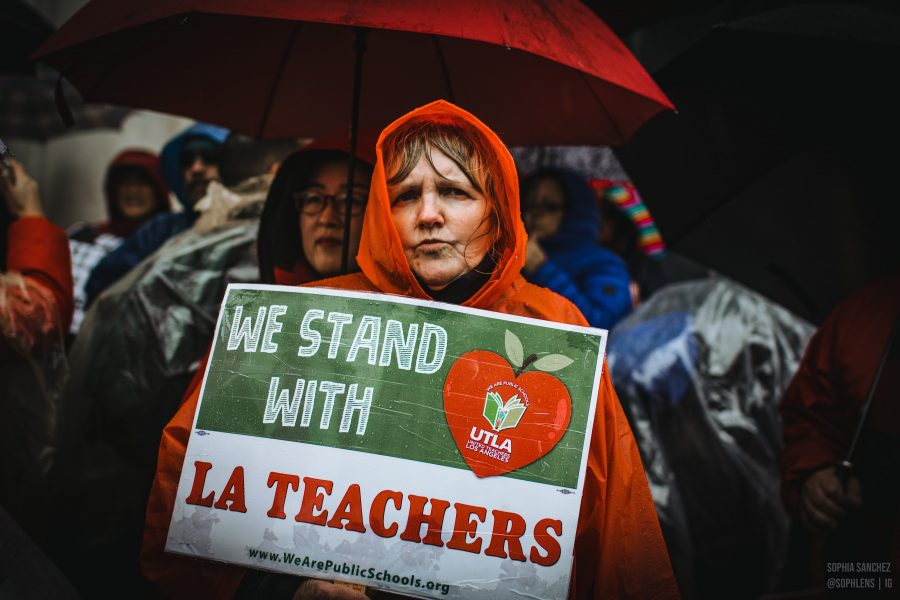 A protester stands in the rain with her sign in downtown Los Angeles on Monday morning. Photo credit: Sophie Sanchez (Los Angeles Center for Enriched Studies '19)