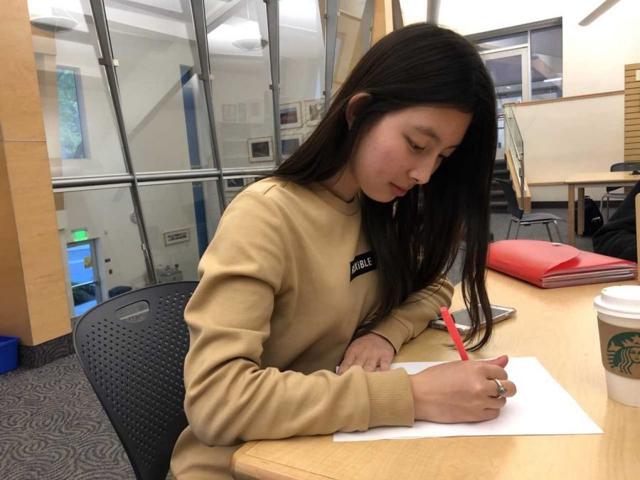 Sketch for Success: Ariana Pineda '21 works on a draft of her Snapchat geotag to submit for the school-wide competition. The winner's drawing will be uploaded as the official geotag for the school.