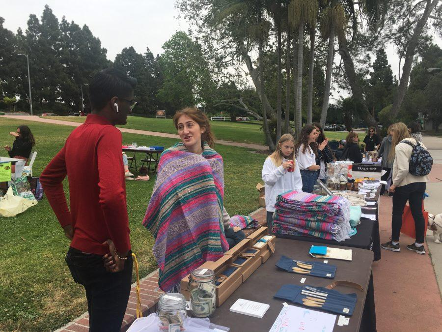 Student Climate Emergency Coalition founder Sonya Ribner '19 interacts with visitors at the first-ever Sustainability Fair in Rancho Park. Credit: Saba Nia/Chronicle