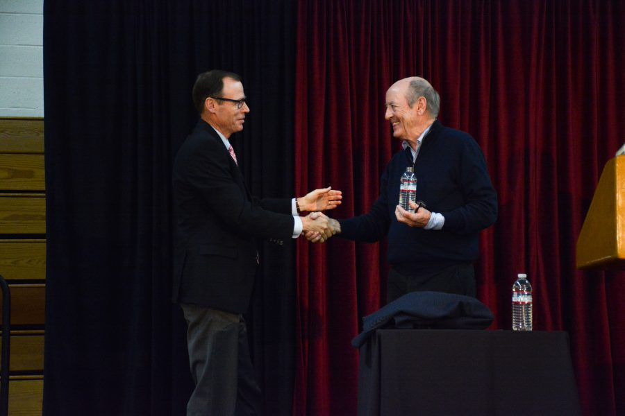 Former U.S. Poet Laureate Billy Collins, right, shakes hands with President Rick Commons.  Credit: Caitlin Chung/ Chronicle