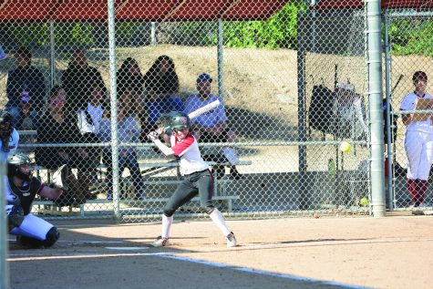 KAT IN THE SOFTBALL HAT: Shortstop Kat Swander '19 prepares to hit in the 7-0 loss against Alemany High School on March 12. The squad is currently 1-1 against Alemany this season, beating the Warriors for the first time April 17 in its second matchup. Credit: Jay Lassiter/Chronicle