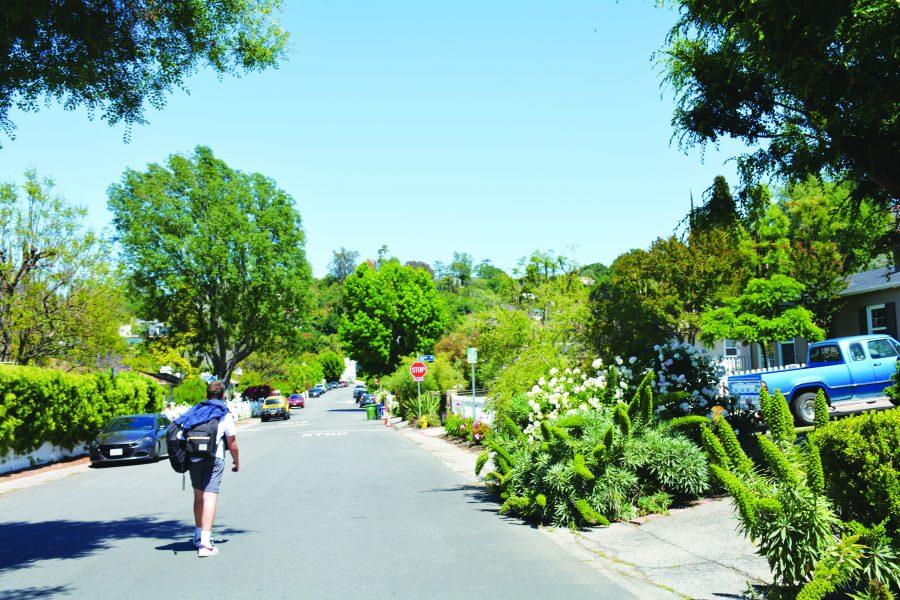 Students walk to their cars parked on Halkirk Street. Beginning the next school year, the school will enforce stricter regulations in order to prevent students from parking in neighboring streets near the upper school campus.
