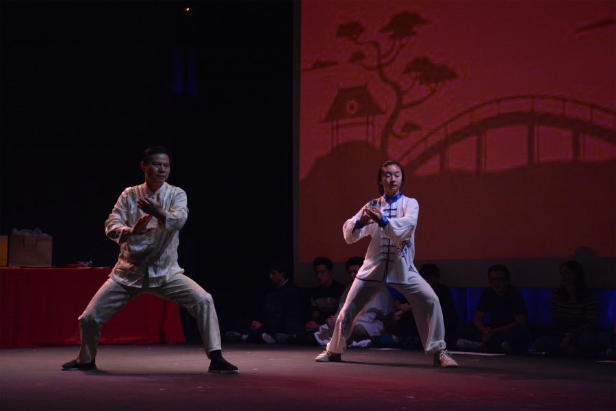 Joy Ho '22 and Dr. Qineng Tan perform a traditional Chinese martial arts routine.  Ho's shocase was one of four performances meant to demonstrate distinct cultural aspects of each language represented.  Credit: Caitlin Chung/ Chronicle