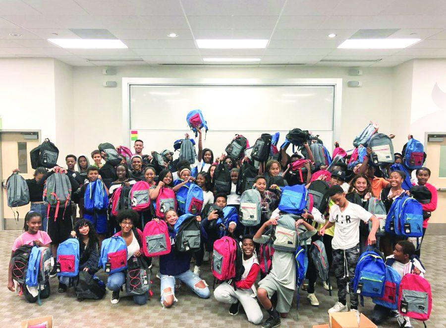 Student members of BLACC helped stuff backpacks to donate to underpriveleged children in the community. During the 30 minute parents and faculty panel, students were able to finish filling 200 bags with school supplies.