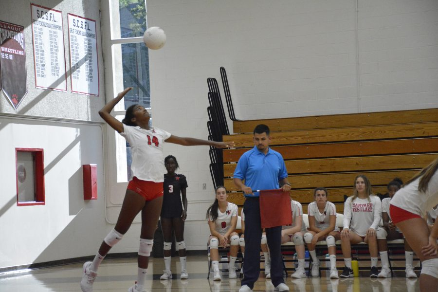 Middle blocker Grace Thrower '23 serves during the second set in the loss to Long Beach Poly today. Credit: Jaidev Pant/Chronicle.
