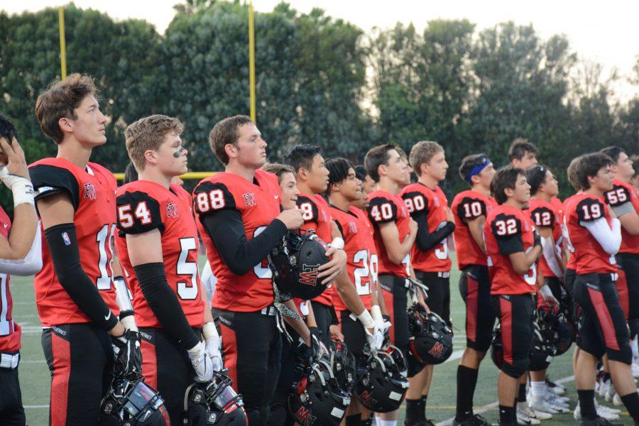 The team stands for the national anthem before the game. Credit: Eugean Choi/Chronicle