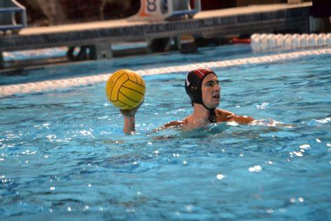 Goalkeeper Nolan Krutonog 20 surveys the pool for teammates in the match against Loyola High School. Credit: Sandra Koretz/Chronicle