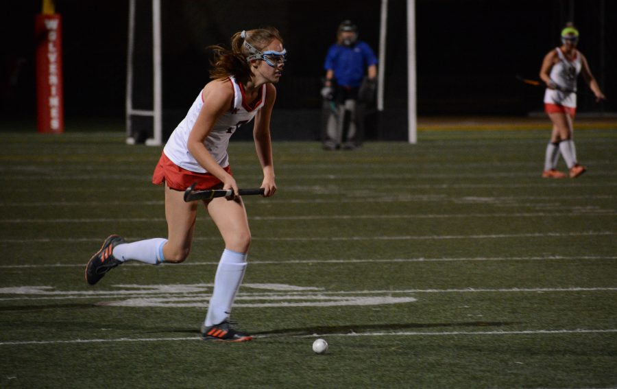 Tessa Augsberger '22 pushes the ball up the pitch against Great Oak in a 8-0 victory. Credit: Lucas Lee/Chronicle