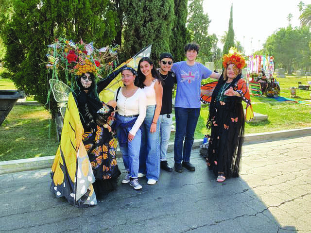 MONARCHS: Criselda Mele '20, Diana Castellanos '20, Lupe Lucero '20 and Osi Holt '20 partake in the Day of the Dead festivities. Printed with permission of Diana Castellanos