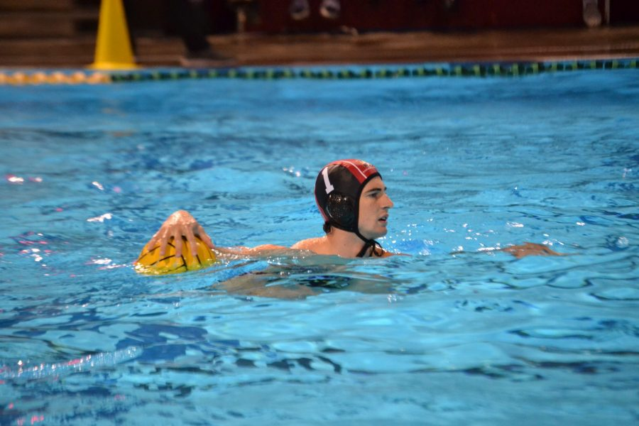 Goalkeeper+Nolan+Krutonog+20+surveys+the+pool+for+teammates+in+a+11-3+victory+against+Mater+Dei+High+School+in+the+first+round+of+CIF+playoffs+Nov+7.++After+a+win+in+the+semi-finals%2C+the+Wolverines+face+a+rematch+against+Newport+Harbor+High+School+in+the+CIF+finals.+Credit%3A+Sandra+Koretz%2FChronicle.+