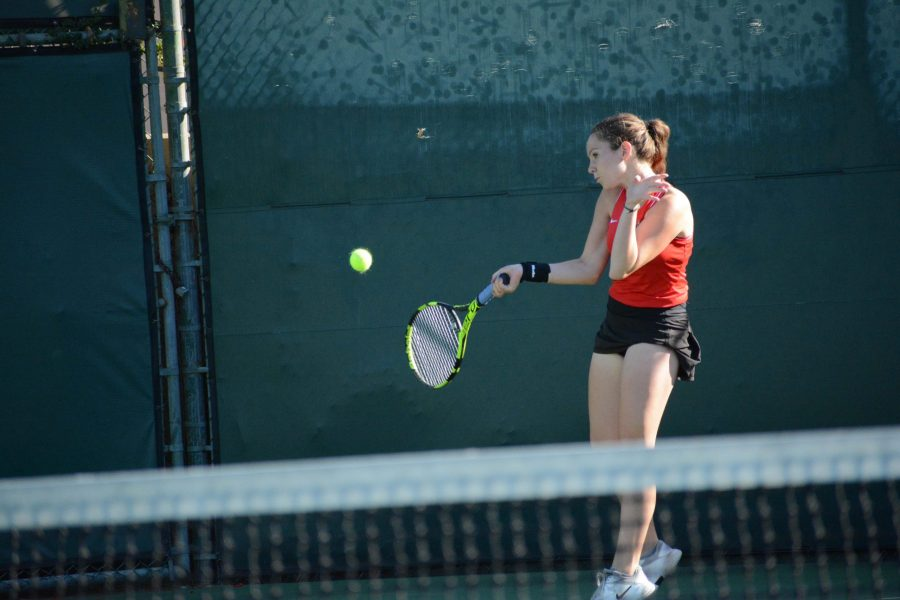 Katherine Konvitz 20 prepares to hit the ball in a 13-5 win against Marymount High School Oct 24 on Senior Night. Credit: Kyle Reims/Chronicle
