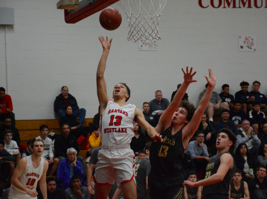 Wing Brase Dottin '20 going up to the basket in a 68-53 win last season over Saint Francis High School. Credit: Keila McCabe/Chronicle