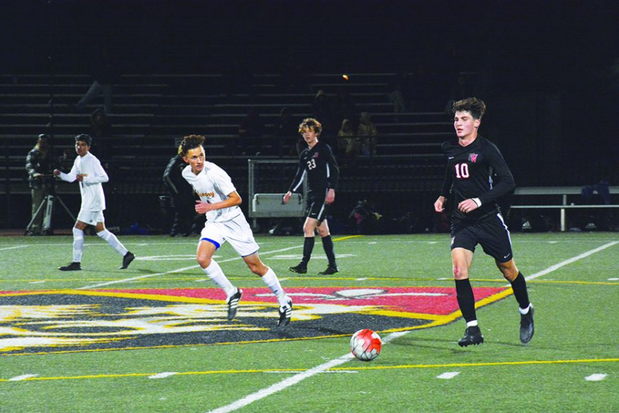 Midfielder Connor Colao '21 dribbles the ball in a 6-2 win at home against league opponent Bishop Alemany High School on Jan. 10. The squad's next game is at home against league opponent Chaminade College Preparatory High School today. Credit: Eugean Choi/Chronicle