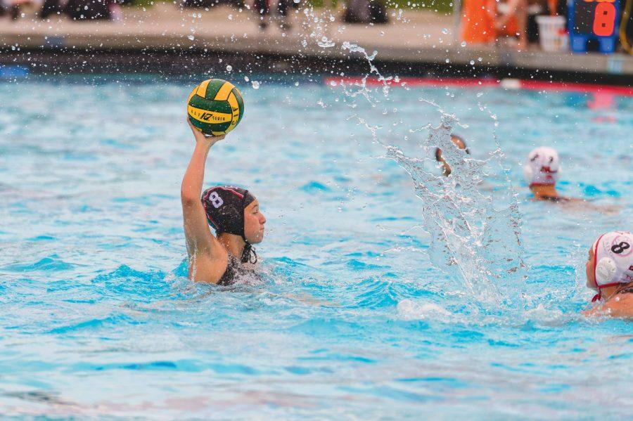 CIF CHAMPS: Attacker Alex Button '21 rises above her opponent, looking to pass in the 13-12 win against San Clemente on Feb. 22. Credit: Woo Sim