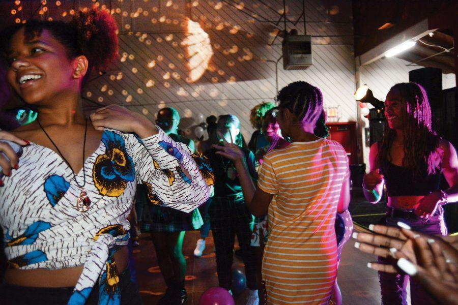 Makeda Neavill '21 dances with fellow students in Hamilton Gym during the BLACC Out Dance event on Friday. BLACC leaders organized the event to encourage students of color from around Los Angeles to celebrate their cultural identities. Credit: Crystal Baik/Chronicle