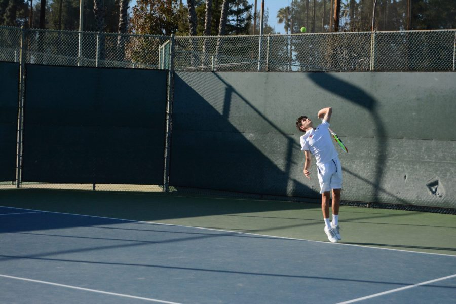 Jonah Dickson 20 serves the ball in a 15-3 win at home against Palos Verdes High School on Mar. 3. Credit: Jaidev Pant/Chronicle