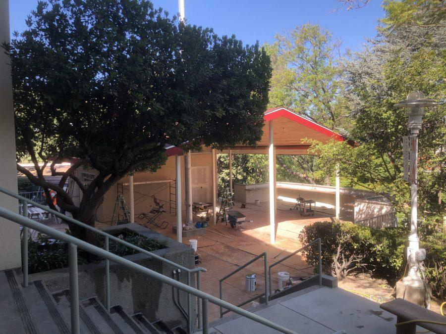Photo by Ethan Lachman |  Construction for the new upper school cafeteria, which aims to account for the new schedule's common lunch period for all students, is nearing completion.The cafeteria has an outdoor sitting area nearby and is located near the steps of the Mudd Library.