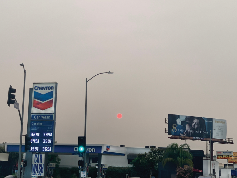 Smoke produced by several wildfires on the Pacific Coast casts a shadow around the sun in Los Angeles. The fires, most of which started burning in late August, are record-breaking, as they killed over 30 people and burned millions of acres from Oregon to Southern California. Credit: Konnie Duan/Chronicle
