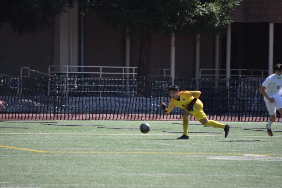 Goalie Jason Salmeron '22 rolls the ball up the field setting up an offensive strike late in the game.