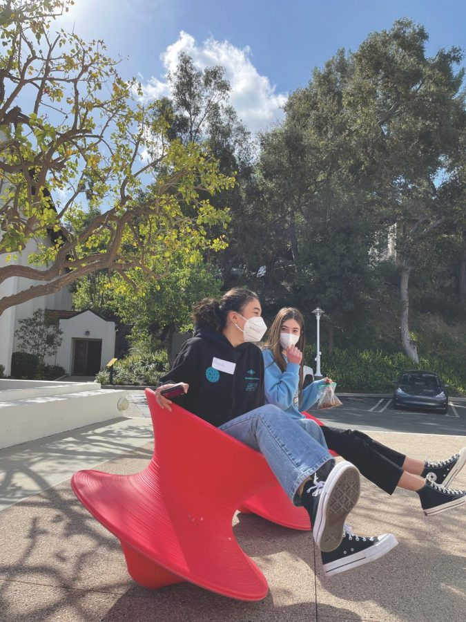 In between online classes on campus, Chloe Fribourg '23 and Lauren LaPorta 23 catch up as they spin together in the chairs outside the visual arts department March 9.