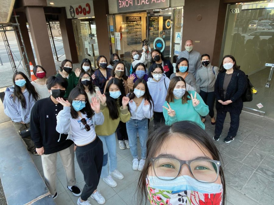 Students+wearing+masks+pose+in+front+of+a+storefront+on+Sawtelle+Boulevard.