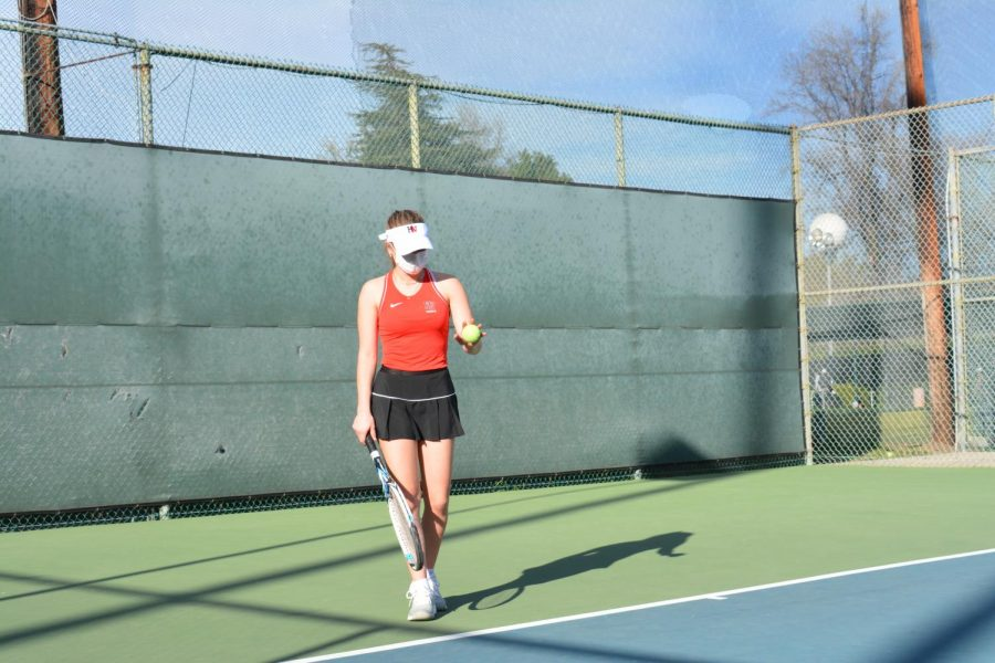 Jade Zoller '21 gets ready to hit the ball against Flintridge Sacred Academy on March 18