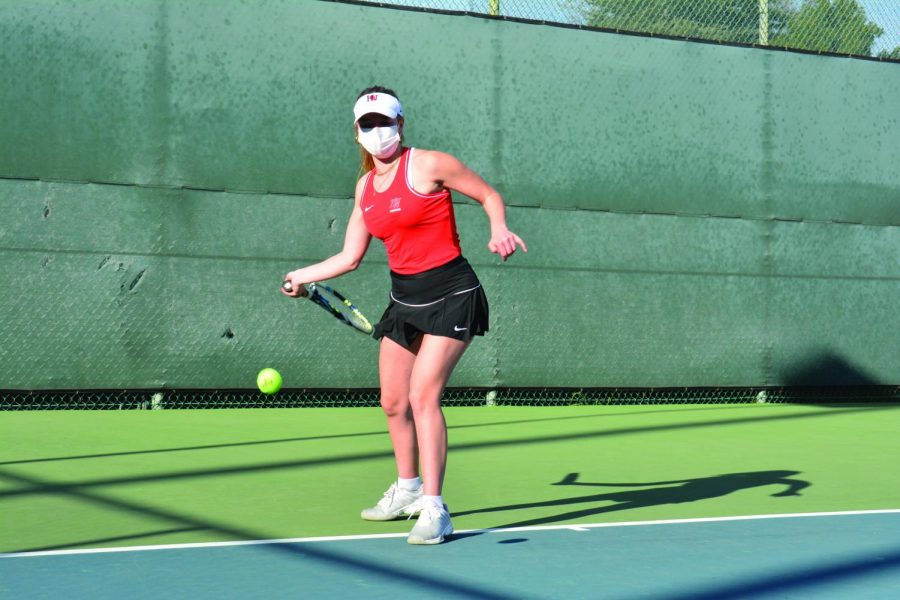 Jade Zoller '22 sets up to hit a high forehand cross court in a match against Notre Dame High School.