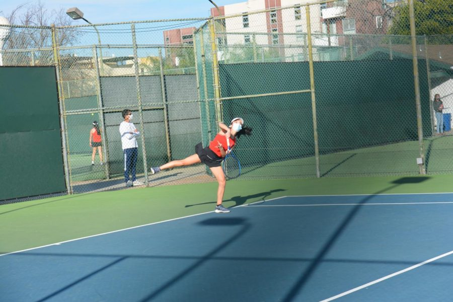 Kimberly+Wang+%2722+looks+to+serve+an+ace+in+her+match+against+Notre+Dame+High+School+on+March+2.+