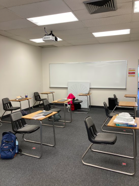 Upper+school+students+leave+behind+an+empty+classroom+with+socially+distanced+tables+as+they+head+out+to+grab+some+lunch+before+resuming+online+classes.+