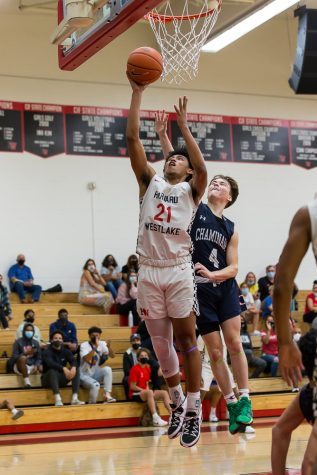 Adam Hinton goes up for a layup in a game against Chaminade College Preparatory High School on May 12.