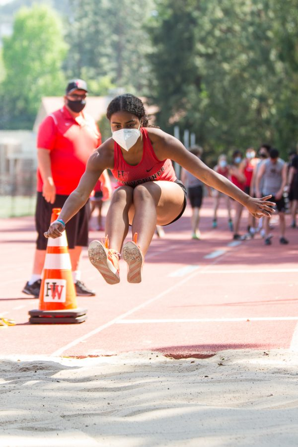 Jessica Thompson '23 soars through the air in the long jump event at a Mission League meet against St. Francis High School on April 17.