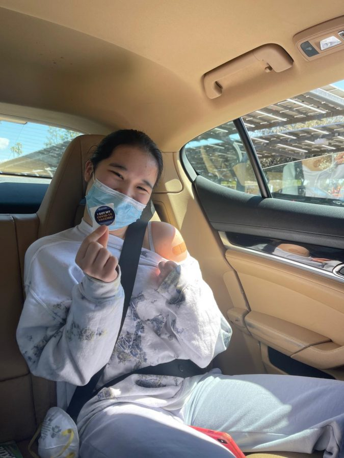 Konnie Duan '23 shows her sticker after receiving the COVID-19 vaccine at a drive-through clinic.