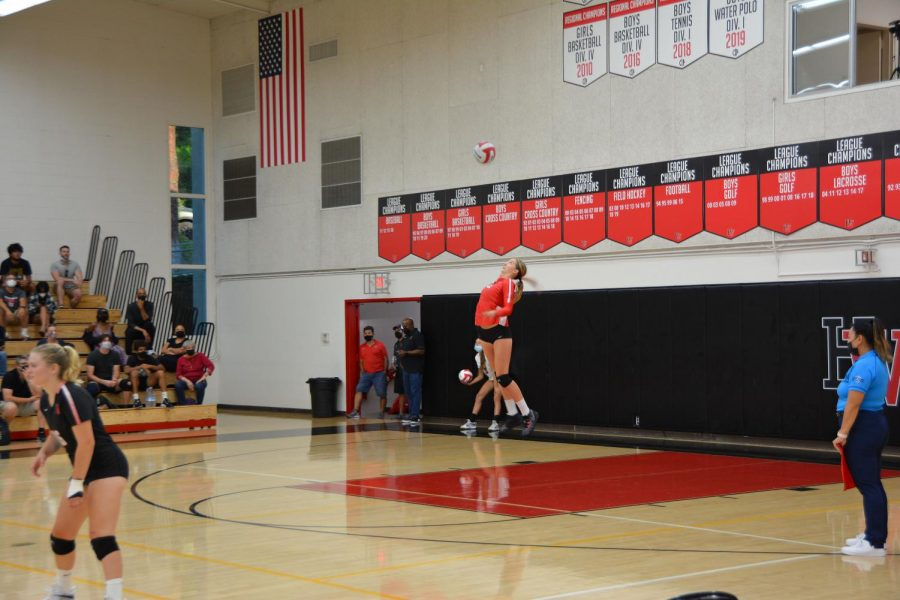 Serve it Up: Ava Lange '23 serves in a 3-0 win against Calabasas High School. The squad dominated, moving to a 3-0 record this season.