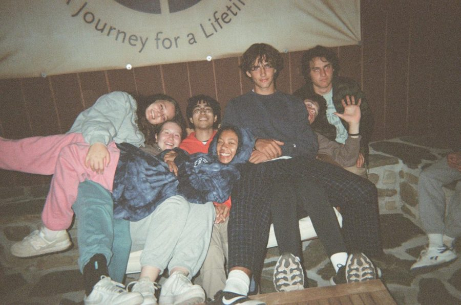 From left to right: Peer Support Leaders and Trainees Lily Saada 22, Eliza Koblentz 23, Alec Rosenthal 22, Sophia Haynes 22, Henry Wendorf 23, Will Sherwood 23 and Harry Tarses 23 relax in their pajamas before going to sleep. The Peer Support retreat is one of the few overnight trips the school has authorized since the pandemic.