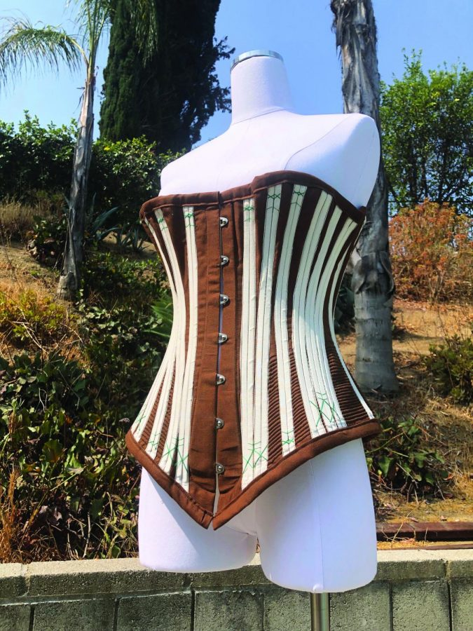GLAMOROUS GARMENTS: Sadye Lackmans 22 finished hand-sewn corset, the final product of the research she conducted during her fellowship, is showcased in her backyard.