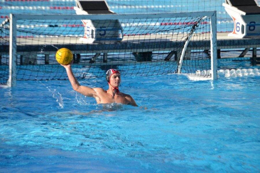 Boys water polo player Baxter Chelsom 23 looks to pass in the 15-6 win against Long Beach Highschool. Credit: Sandra Kortez/Chronicle