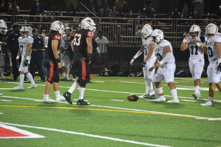 Edward Kim 23 and William Ehrlich 22 prepare to snap the ball in a 26-58 defeat against St. Genevieve High School Sept. 11.