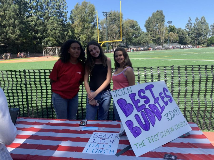 Idalis McZeal 23, Jane Hamilton 22 and Ava Weinrot 23 run the Best Buddies club booth, having secured a spot out of the blazing sun.
