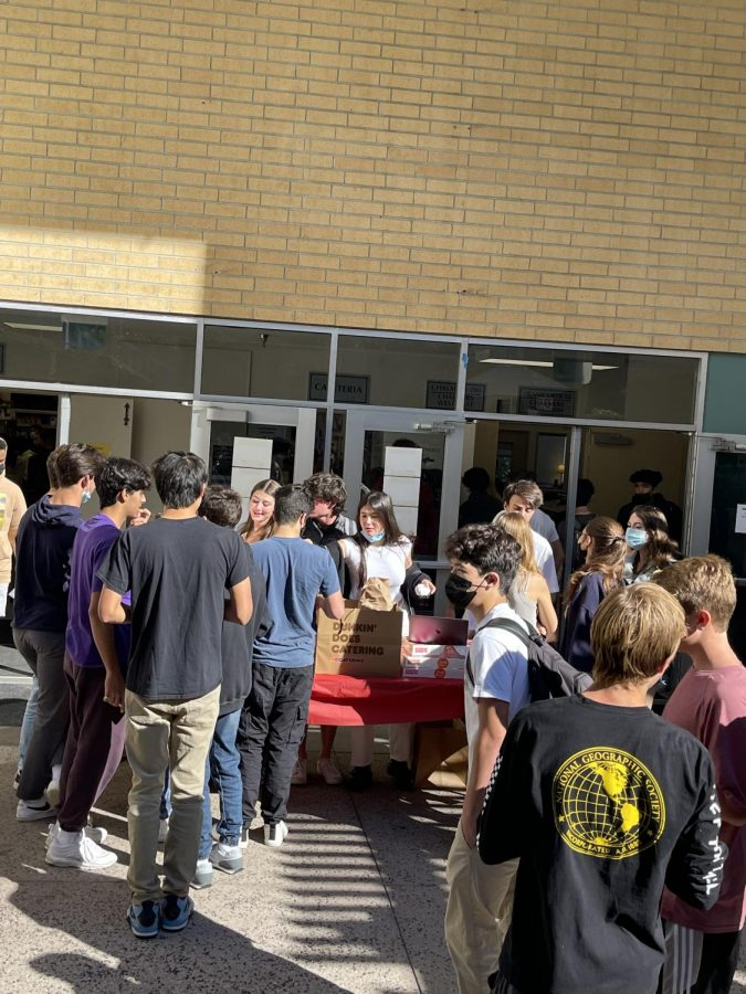 Upper school students line up outside Chalmers to complete their registration and receive Dunkin' Donuts, with their Social Security numbers in hand.