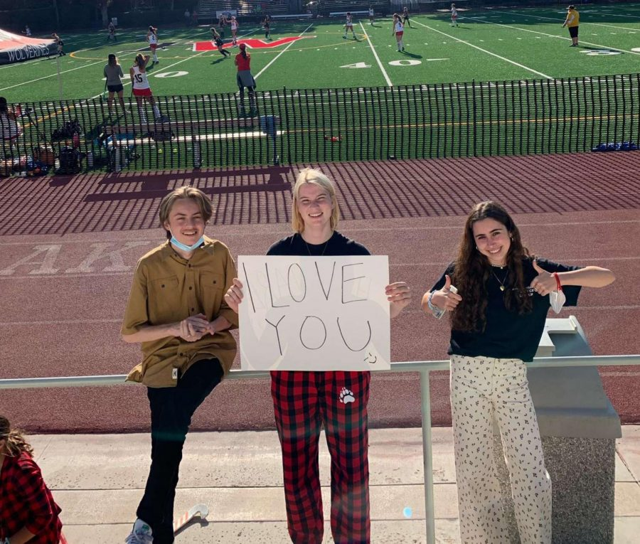 With a handmade sign, newly-elected Head Fanatics Ridley Berger-Sacks '22, Kate Hasset '22 and Julianna Ross '22 cheer on the girl's field hockey game. In addition to sports events, the fanatics will attend art performances this year.