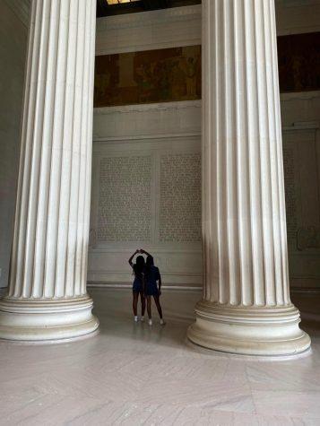 Ella Watkins 22 and Olivia Sparks 22 gaze upward during their Junior Fellowship at the Lincoln Memorial in Washington D.C.