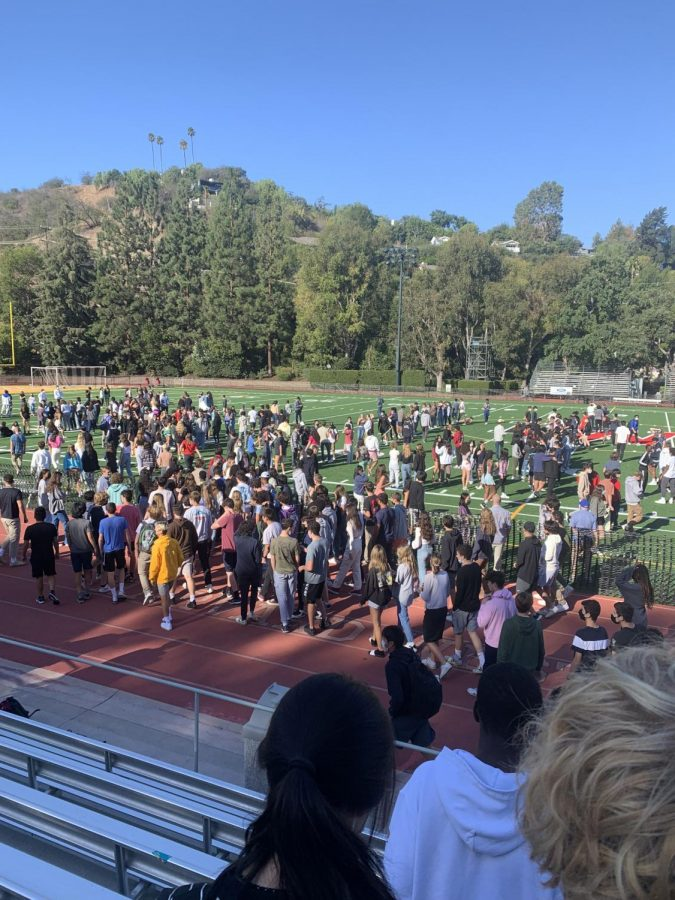 Students evacuate and gather on the Ted Slavin Field after the fire alarm went off.