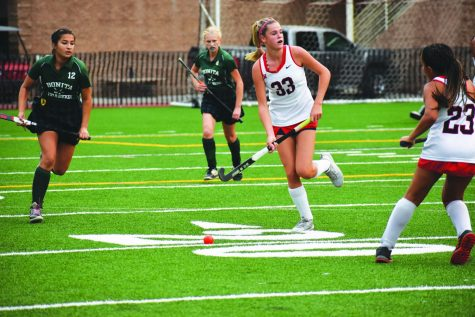 DRIVING THE CHARGE: After six straight wins at the start of the season, Fiene Oerlemans '22 scans the field in a loss against Bonita High School on Ted Slavin Field on Sept. 23. The team bounced back from the loss with a 6-0 closeout win against Edison High School on Oct. 1.