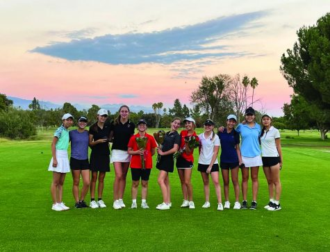 SENIOR FESTIVITIES: On Senior Night the team gathered on the golf course to celebrate is season. Captains Alexa Sen 22, Marine Degryse 22 and Sports Section Editor Maxine Zuriff 22 were gifted roses as a tradition.