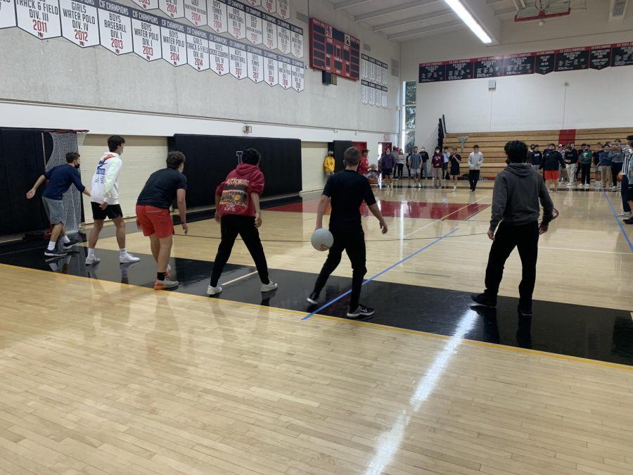 Students face off in a dodgeball match during Community Flex Time in Taper Gymnasium.