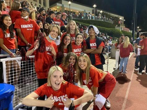 Head Fanatics pose by the bleachers while they cheer on the football team against Mary Star of the Sea High School.
