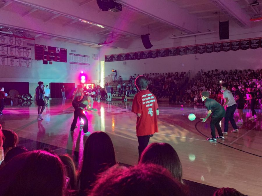 Fall sports team captains play a round of dodgeball against a team of teachers.
